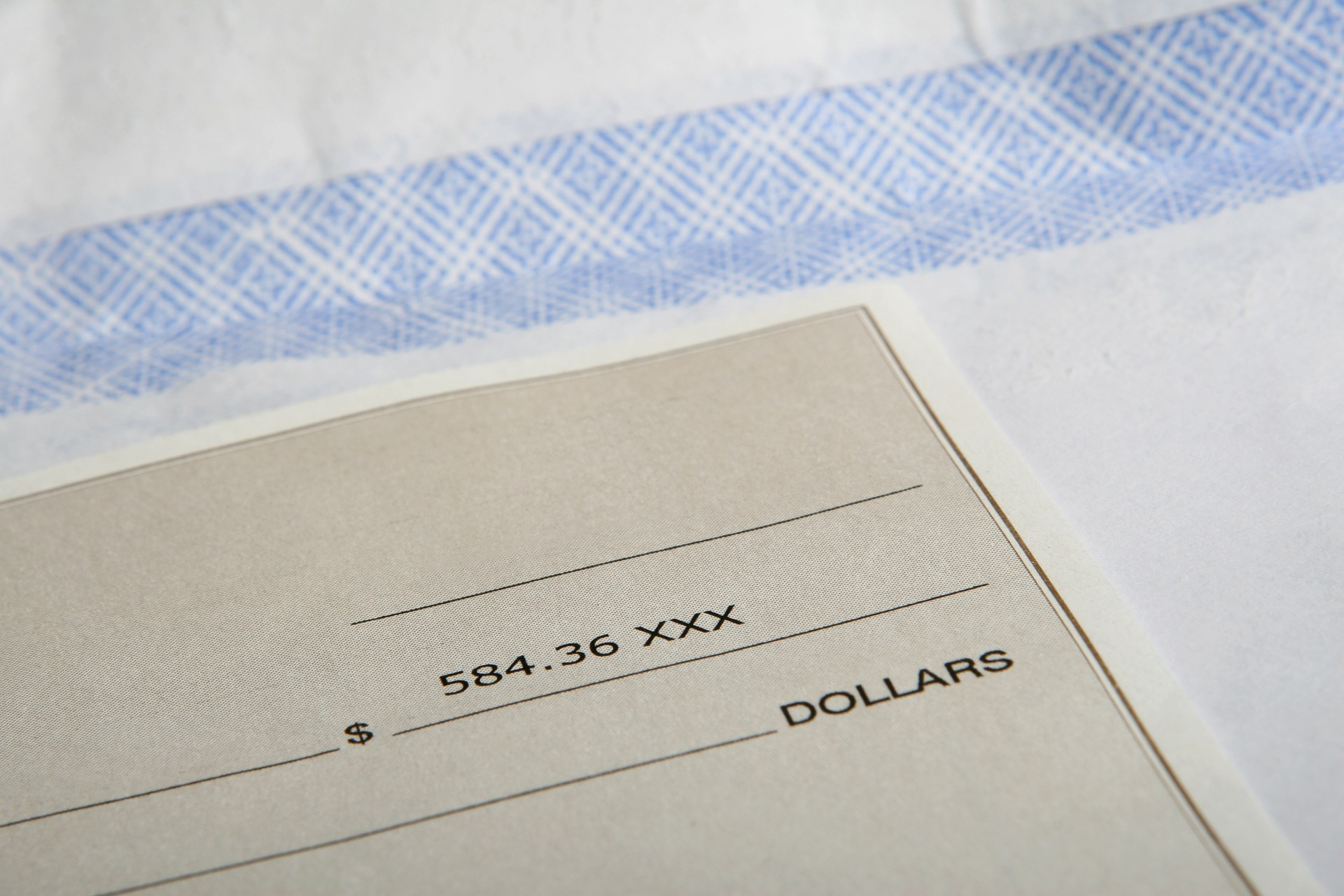 upclose-picture-of-a-paycheck-and-envelope