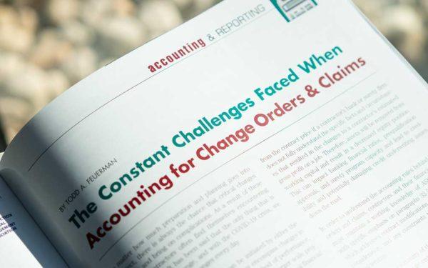 CFMA-building-profits-magazine-on-table