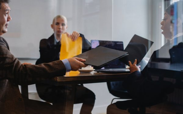 three-people-in-a-business-meeting