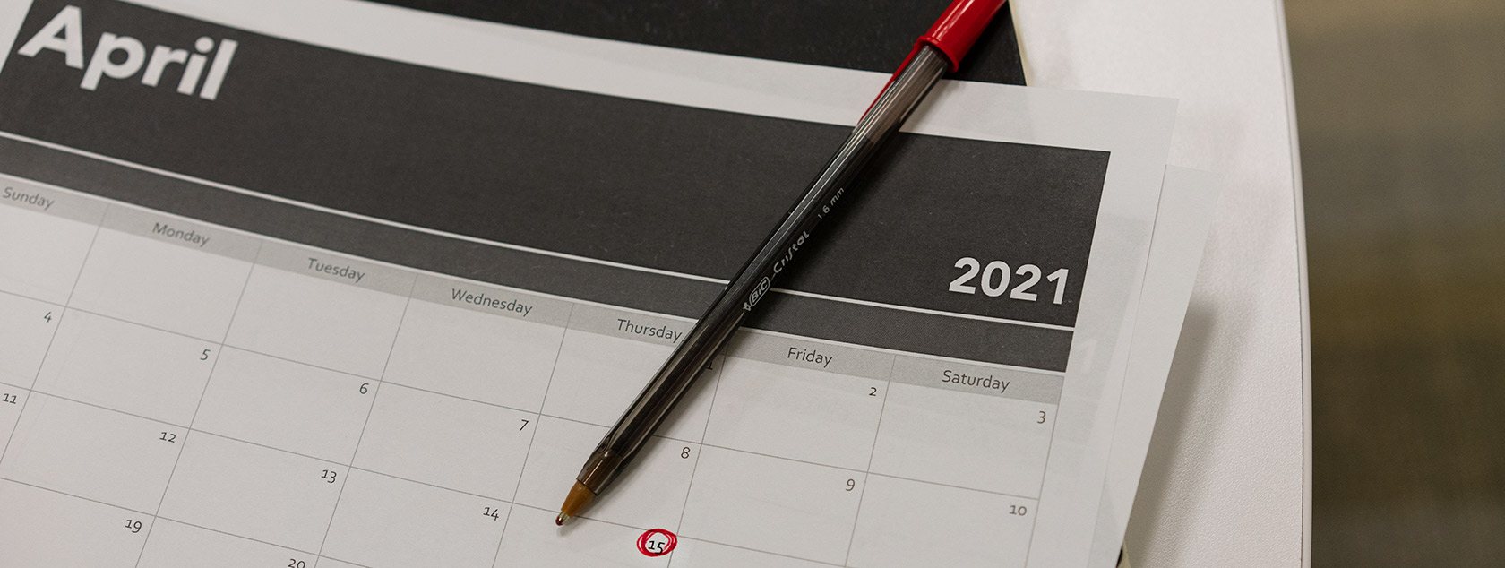 April-2021-calendar-page-with-15th-circled-in-red-pen