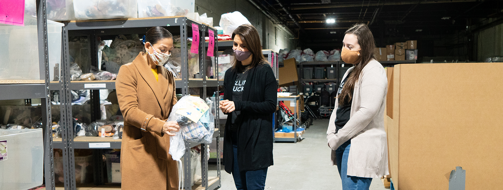 Amina-Osman-Weiskerger-executive-director-of-sharebaby-gives-ellin-&-tucker-employees-tour-of-warehouse