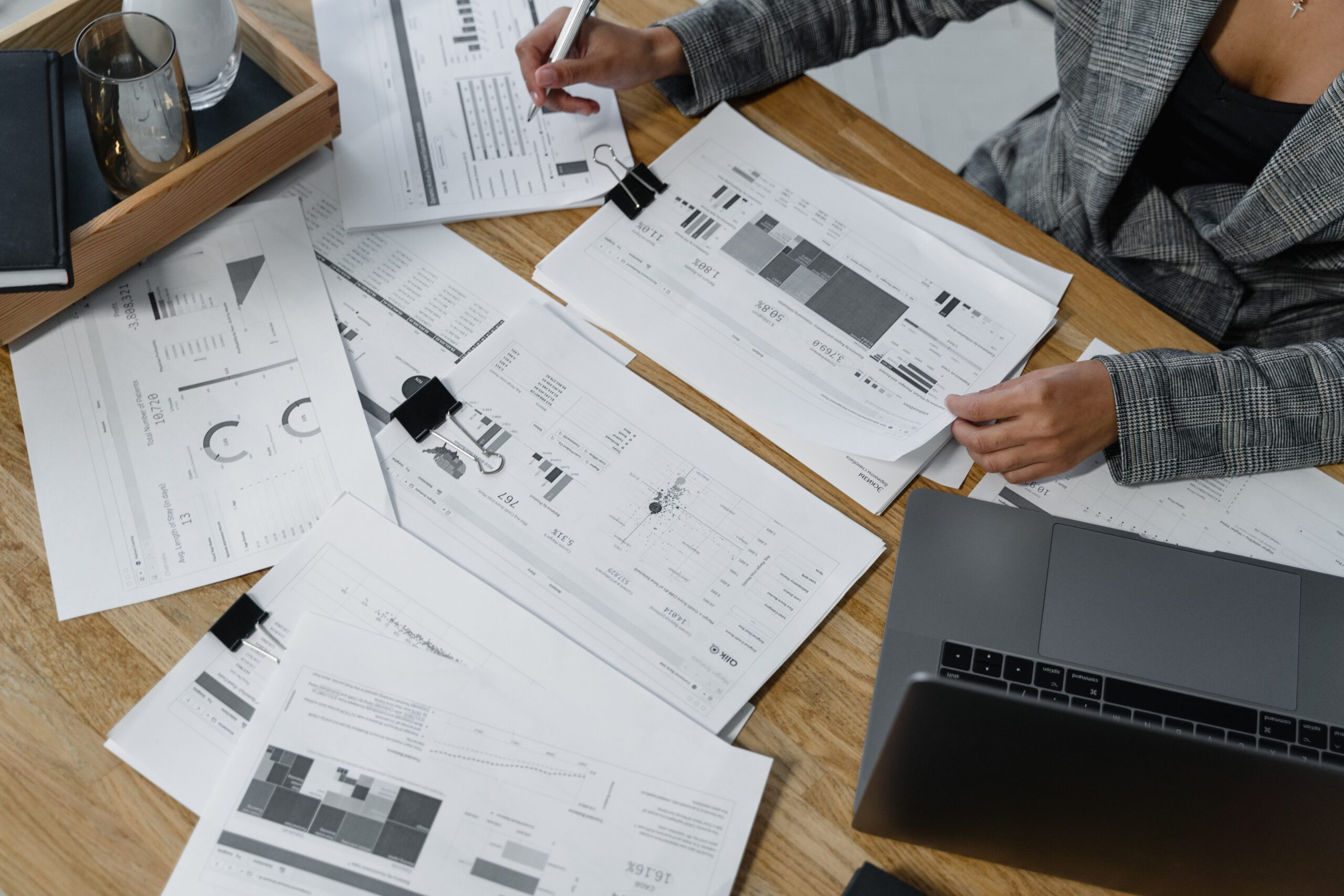 woman-sitting-at-desk-reviewing-business-reports