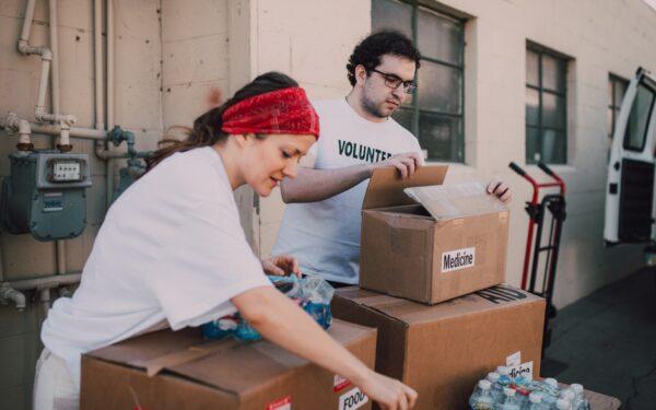 woman and man volunteering at food bank