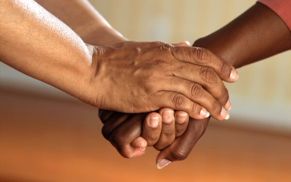 person-clasping-another-persons-hands